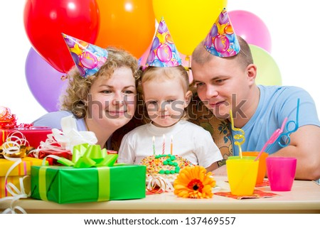 kid girl with parents on birthday party