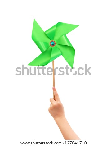 Kid hand holding a green pinwheel close up isolated on white background. - stock photo