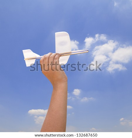 Kid hand holding a model airplane - stock photo