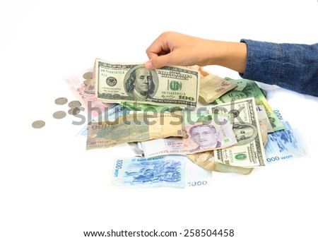 Kid hand picking american dollar bank note from other - stock photo