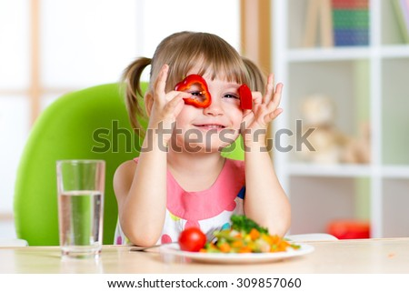 kid having fun with food vegetables in children room