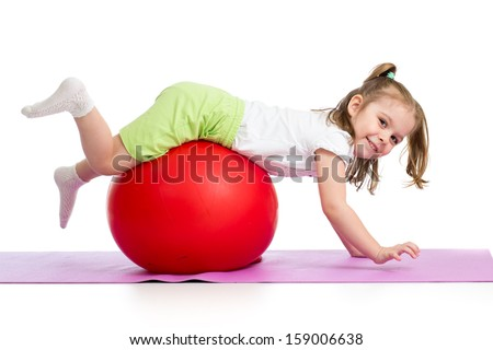 Kid having fun with  gymnastic ball isolated - stock photo
