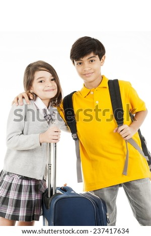 Kid holding a bag over white background . - stock photo