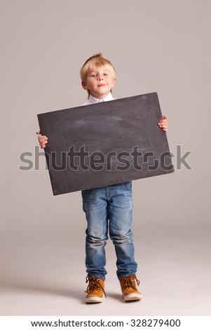 Kid holding a black board - stock photo
