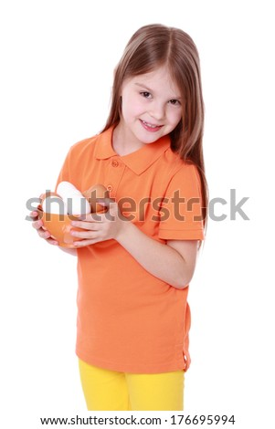 kid holding a bowl of eggs - stock photo