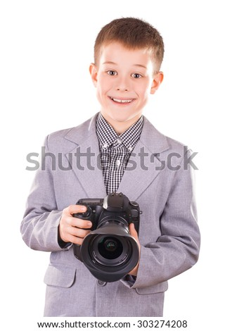 kid holding a dslr camera isolated on the white - stock photo