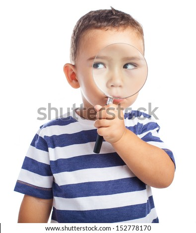 kid holding a magnifying glass on a white background - stock photo