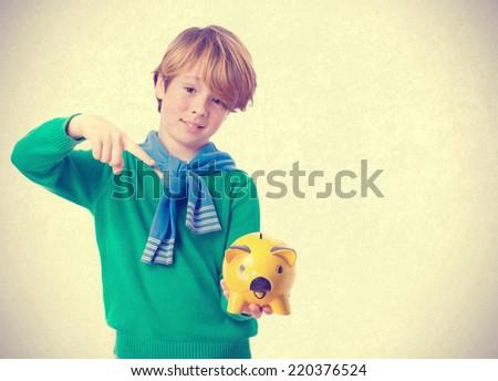 Kid holding a piggy bank - stock photo
