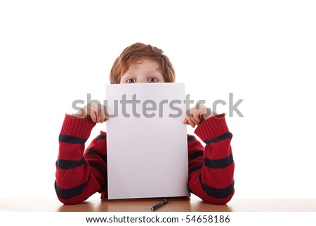 kid holding a white sheet of paper in his hand; isolated on the white background. Studio shot. - stock photo