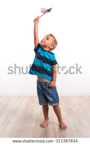 Kid holding an american flag - stock photo