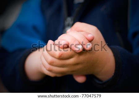 Kid holding hands together