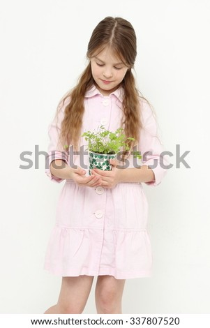 Kid holding parsley