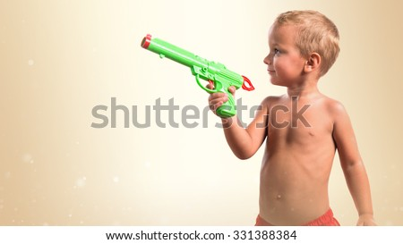 Kid holding plastic gun - stock photo