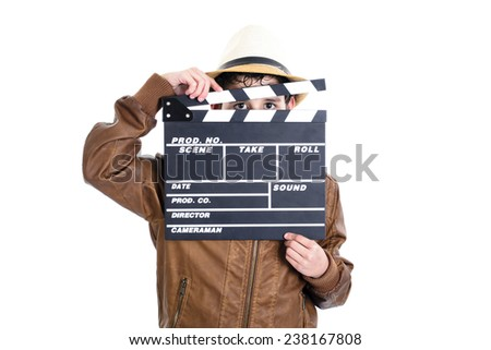 Kid holding the clapperboard covering her face leaving her eyes uncovered - stock photo