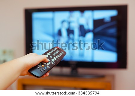 Kid holding TV remote controller