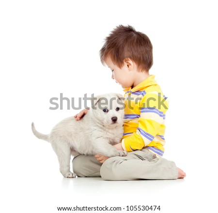 kid hugging puppy on white background - stock photo