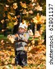 Kid in autumn wood - stock photo