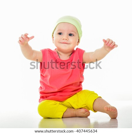 Kid in bright summer clothes. Beautiful happy baby. One, isolated on white. Laughing baby. - stock photo