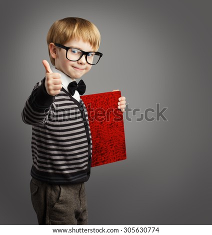 Kid in Glasses, Child Advertiser Certificate Book, School Boy Showing Thumb Up, Certification Education - stock photo
