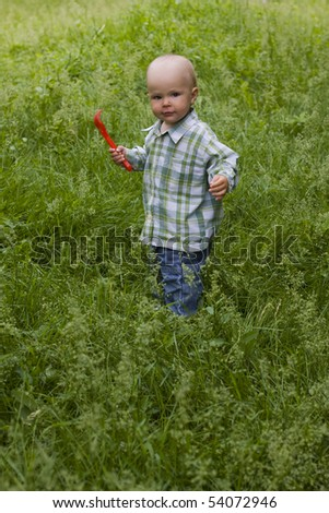 Kid in grass