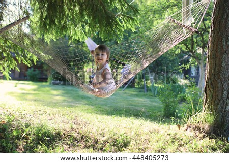 kid in hammock on nature