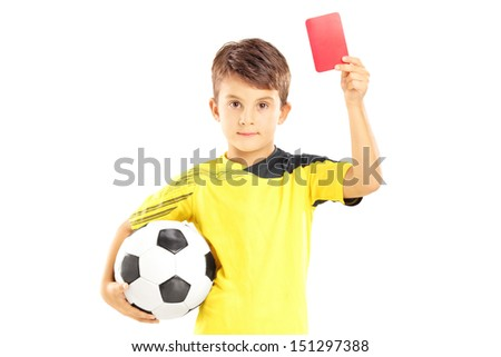 Kid in sportswear holding soccer ball and giving red card isolated on white background - stock photo