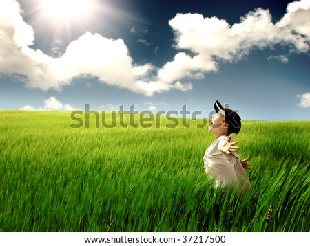 kid in the field - stock photo