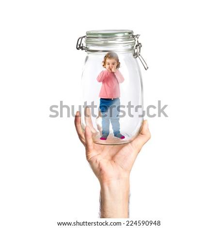 Kid inside glass jar - stock photo