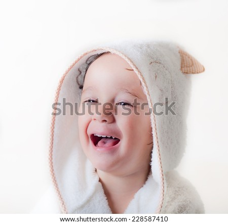 kid is laughing with a bathrobe  - stock photo