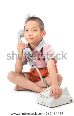 Kid is talking on the phone. Model. Set the table. Business communication concept. Isolated with white background