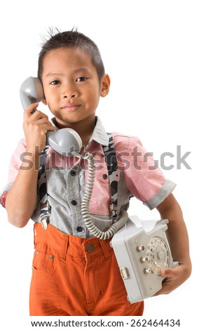Kid is talking on the phone. Model. Set the table. Business communication concept. Kid is talking on the phone. Model. Set the table. Business communication concept.  Isolated with white background