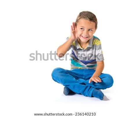 Kid listening something - stock photo