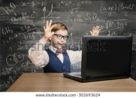 Kid Looking at Laptop, Child with Notebook, Little Boy Mathematics Formula on Chalkboard - stock photo