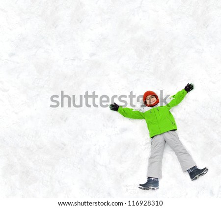 Kid making a snow angel - stock photo