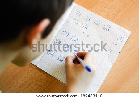 Kid making home work for school - stock photo