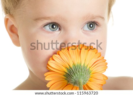 kid on a white background with natural flowers - stock photo