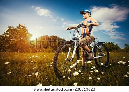 kid on bicycle. Active Leisure - stock photo