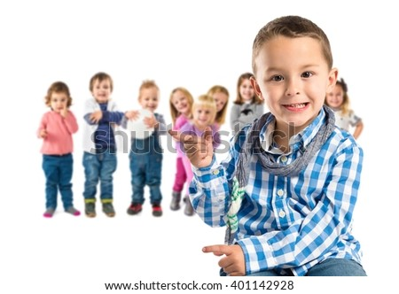 Kid on chair pointing over white background