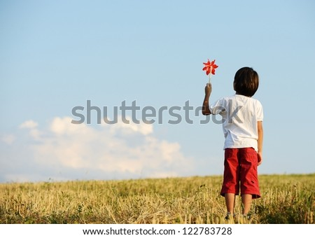 Kid on field - stock photo