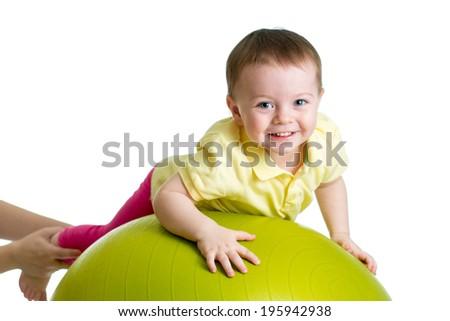 kid on gymnastic ball - stock photo