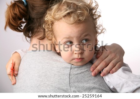 Kid on mothers hands. - stock photo
