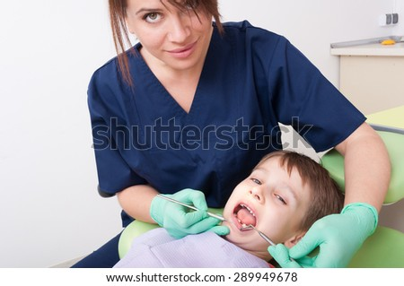 Kid or boy at dentist. Oral exam for kids concept - stock photo