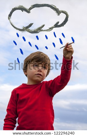 kid painting rain cloud - stock photo