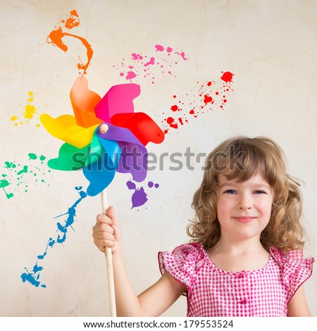 Kid painting wall. Spring renovation concept - stock photo