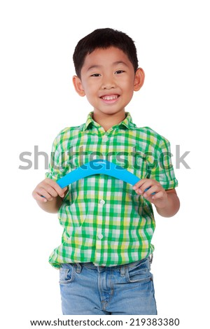 Kid play with boomerang isolate white background - stock photo