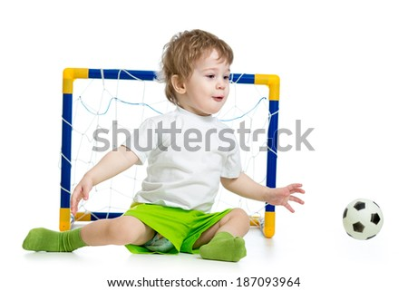 kid playing football and catching soccer ball - stock photo