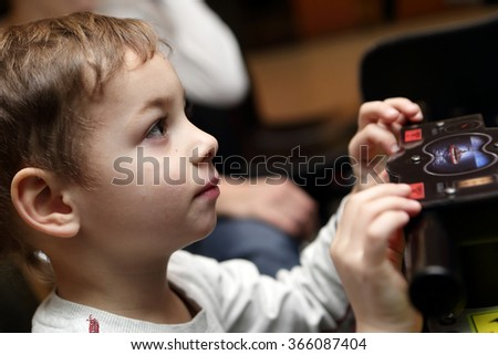 Kid playing shooting game at playground - stock photo