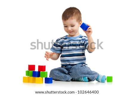 kid playing toy blocks - stock photo