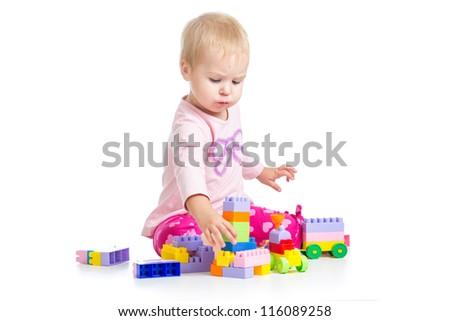 kid playing toy blocks isolated on white background - stock photo
