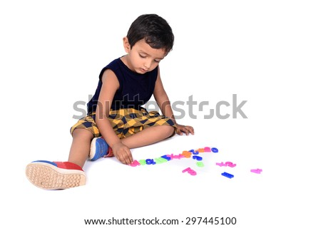 Kid Playing with Alphabets  - stock photo